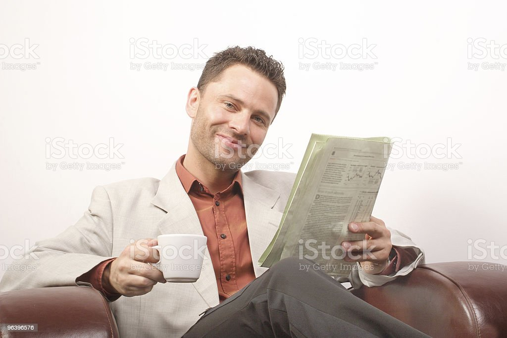 Smiling handsome man with newspaper and cup of coffee - Royalty-free Adult Stock Photo
