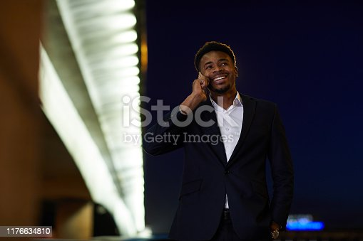 Businessman coming home at night