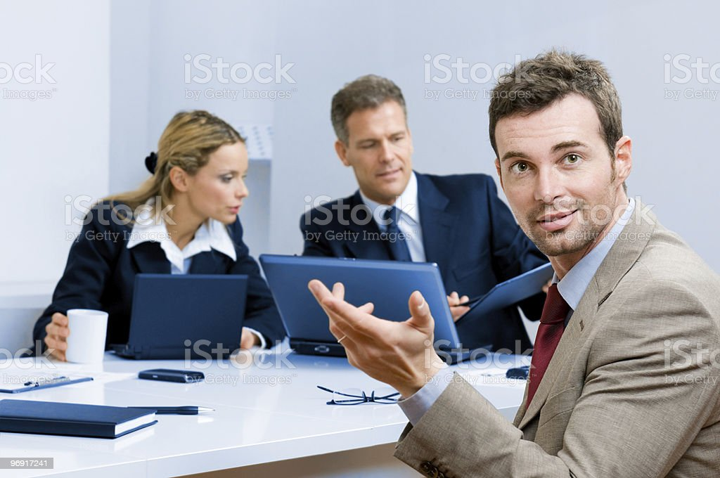 Smiling happy business man in office royalty-free stock photo