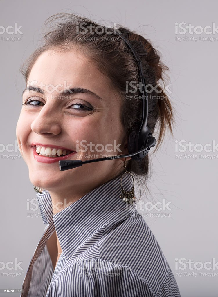 Smiling happy businesswoman wearing a headphone stock photo