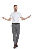 istock smiling happy casual man welcoming 1131988518