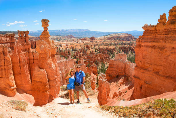 Smiling happy  couple embracing on vacation in the red mountains stock photo