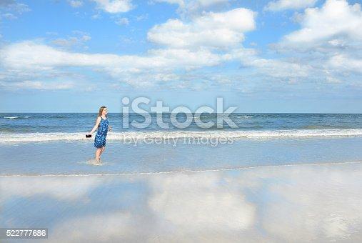 istock Smiling, happy girl enjoying day on the beach. 522777686