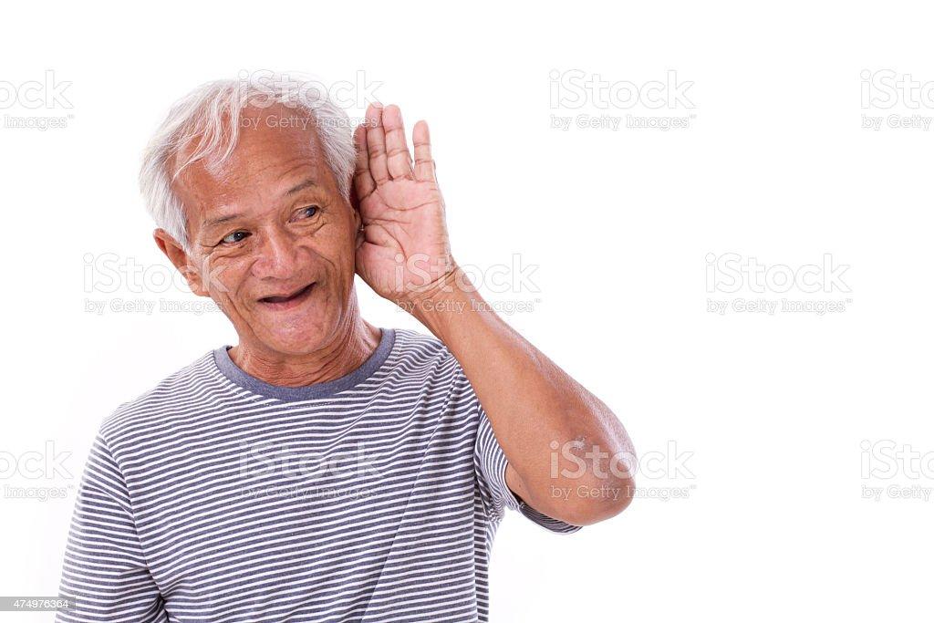 smiling, happy senior old man listening stock photo