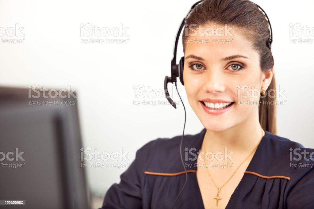 Smiling happy woman at her workplace in the office. royalty-free stock photo