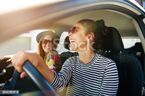 istock Smiling happy woman giving her friend a lift 603285918