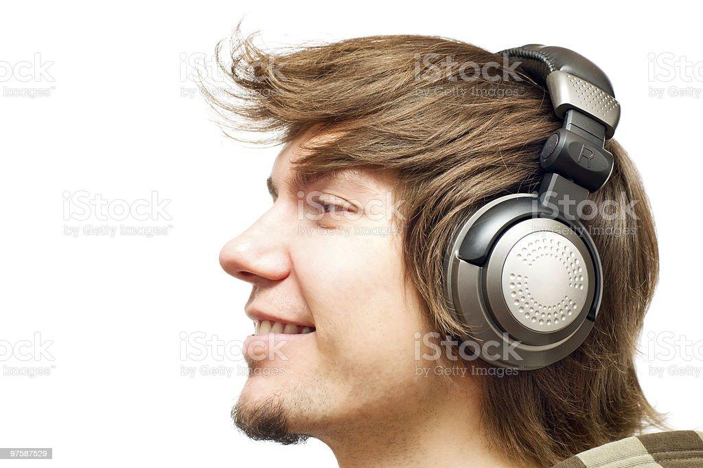 smiling happy young man in a headphones royaltyfri bildbanksbilder