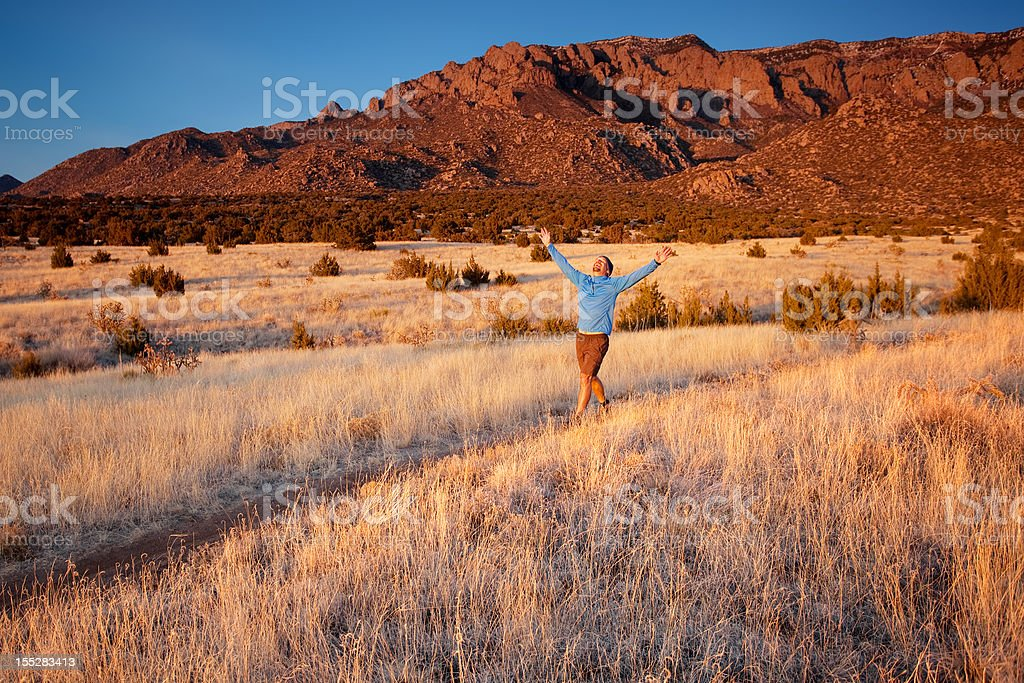 smiling hiker with arms spread wide royalty-free stock photo