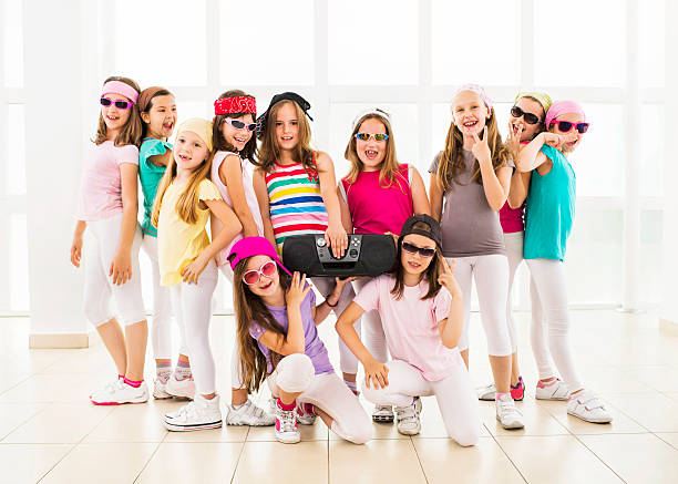 smiling hip hop dance group. - dance group stock photos and pictures