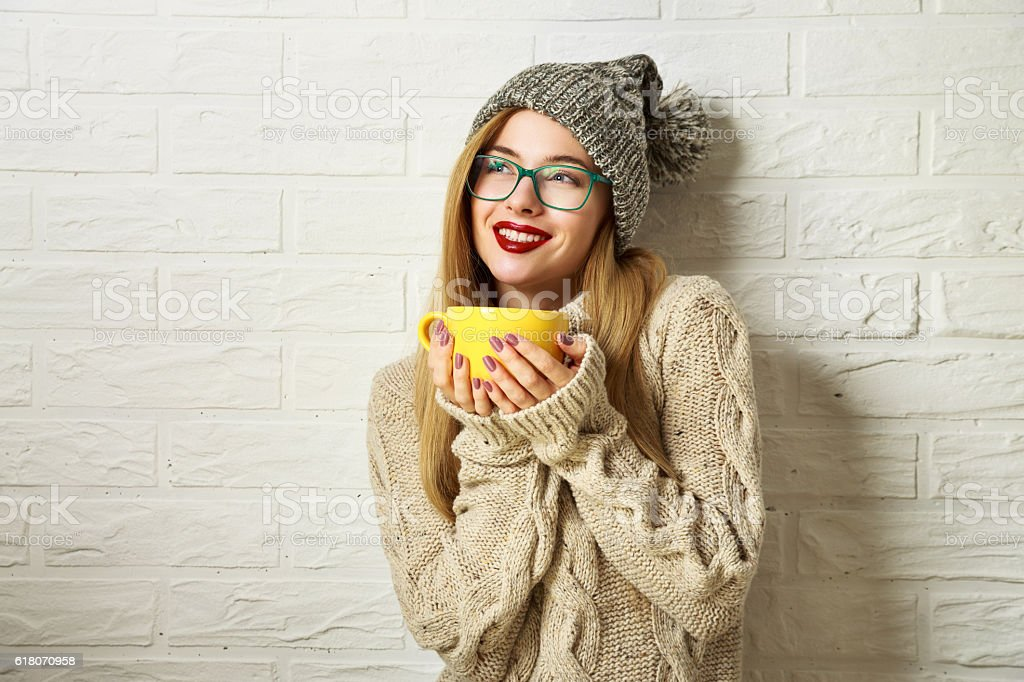 Smiling Hipster Girl in Winter Clothes with a Mug - Photo