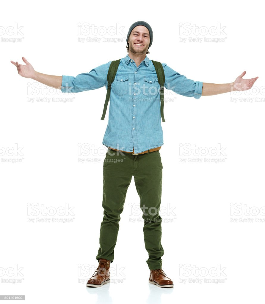 Smiling hipster standing with arms outstretched stock photo