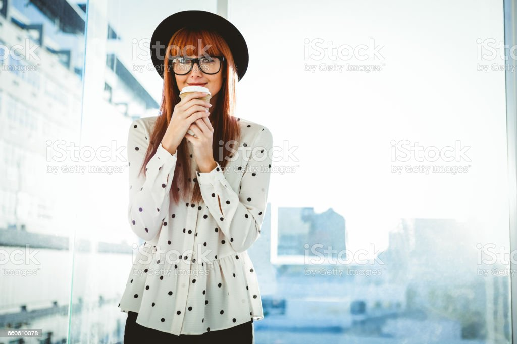 Smiling hipster woman drinking coffee royalty-free stock photo