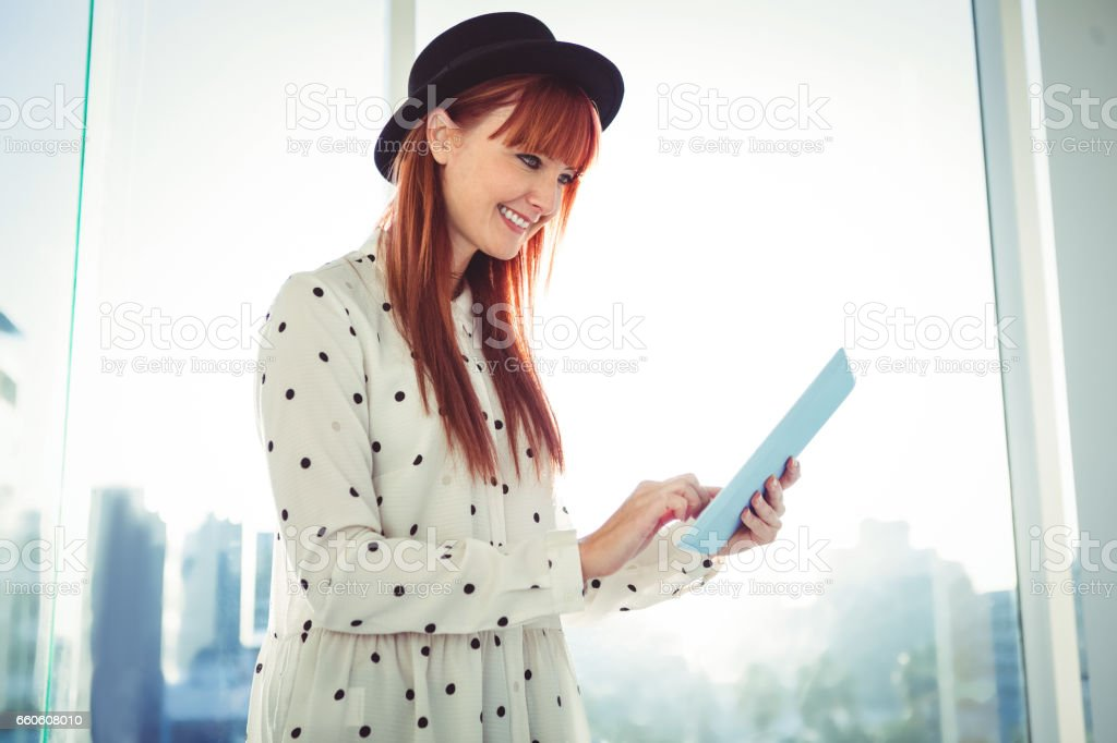 Smiling hipster woman using her tablet royalty-free stock photo