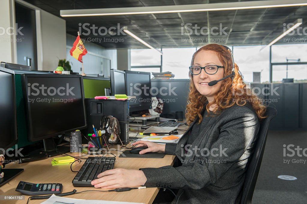 Smiling hispanic lady in office royalty-free stock photo