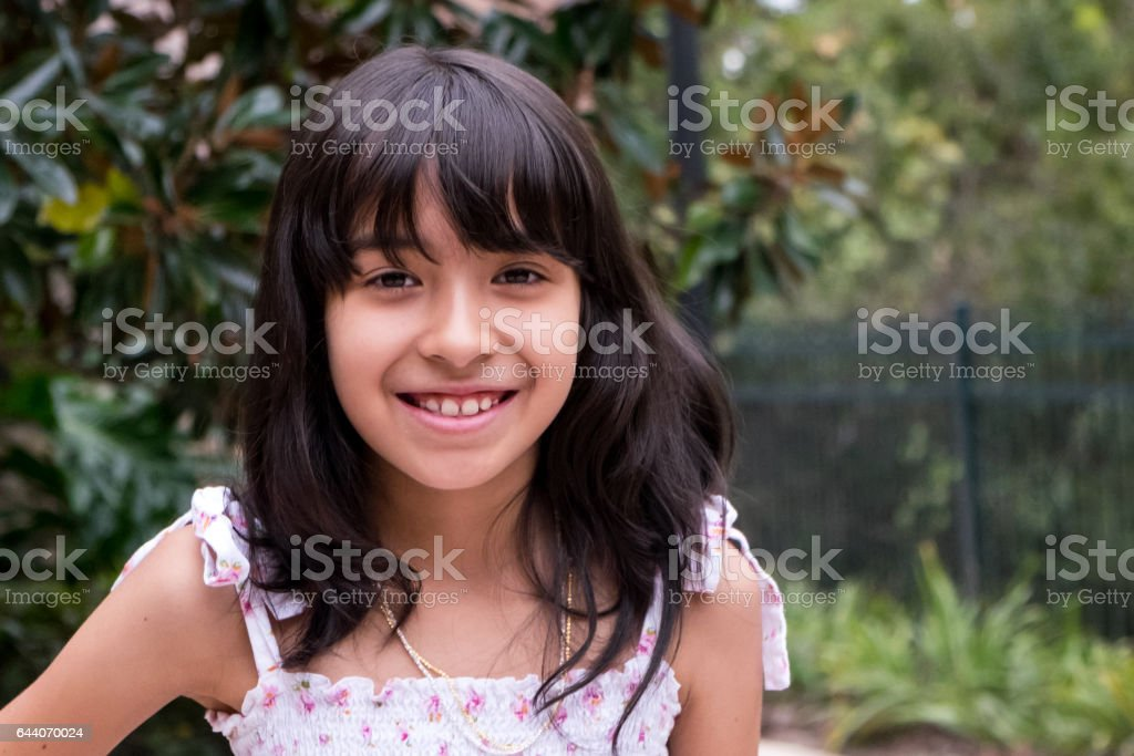 Smiling hispanic little girl stock photo
