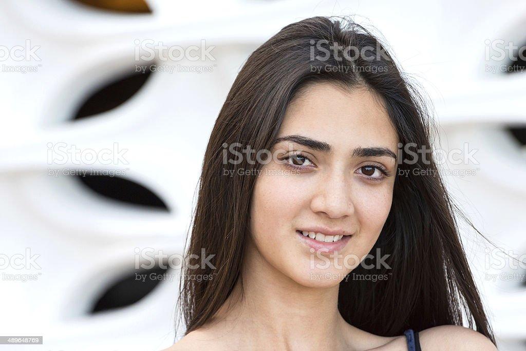 Smiling hispanic teenage girl stock photo