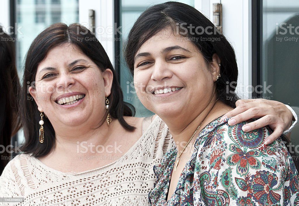 smiling hispanic women stock photo