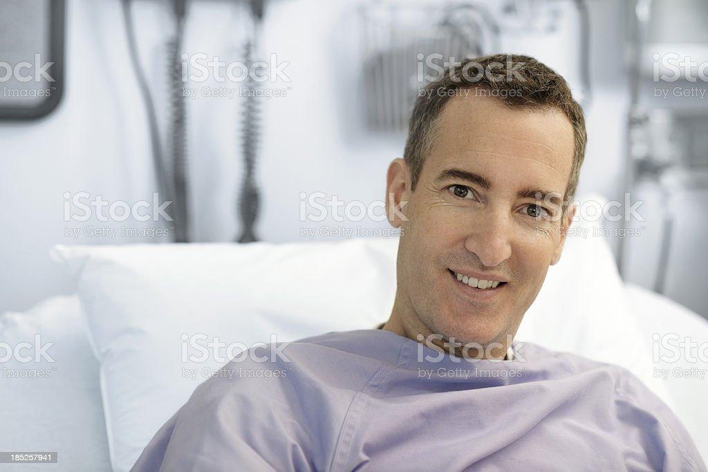 Smiling hopeful hospital patient stock photo