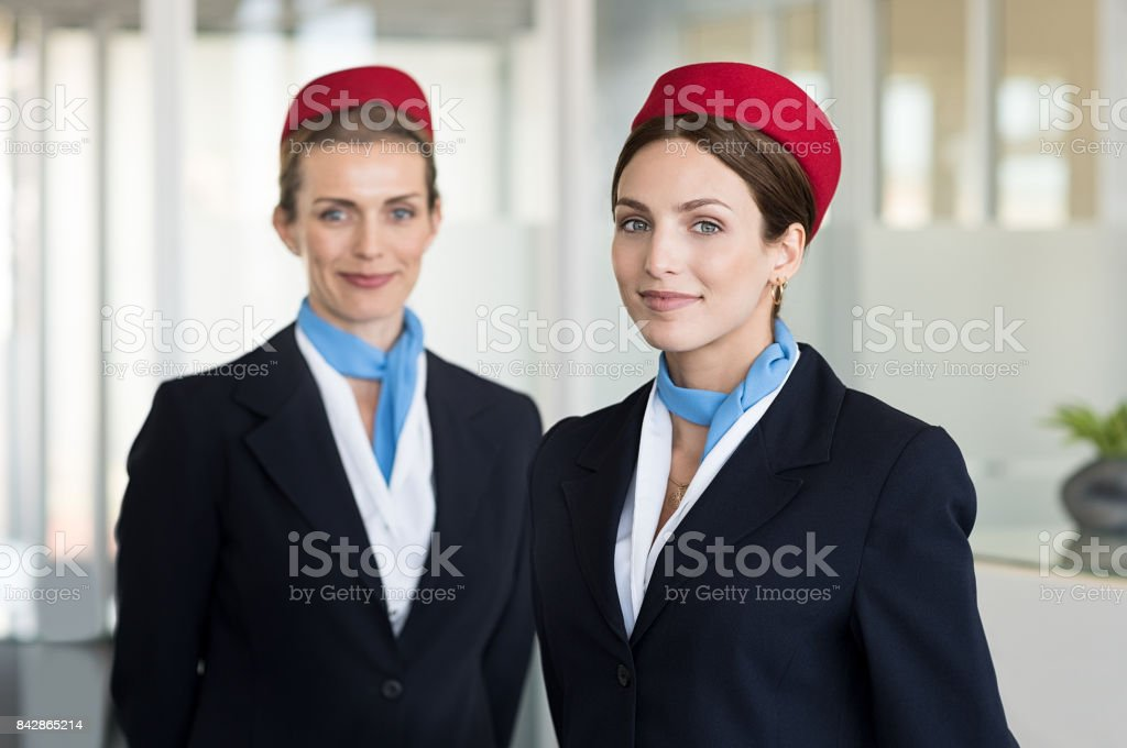 Smiling hostess at airport stock photo