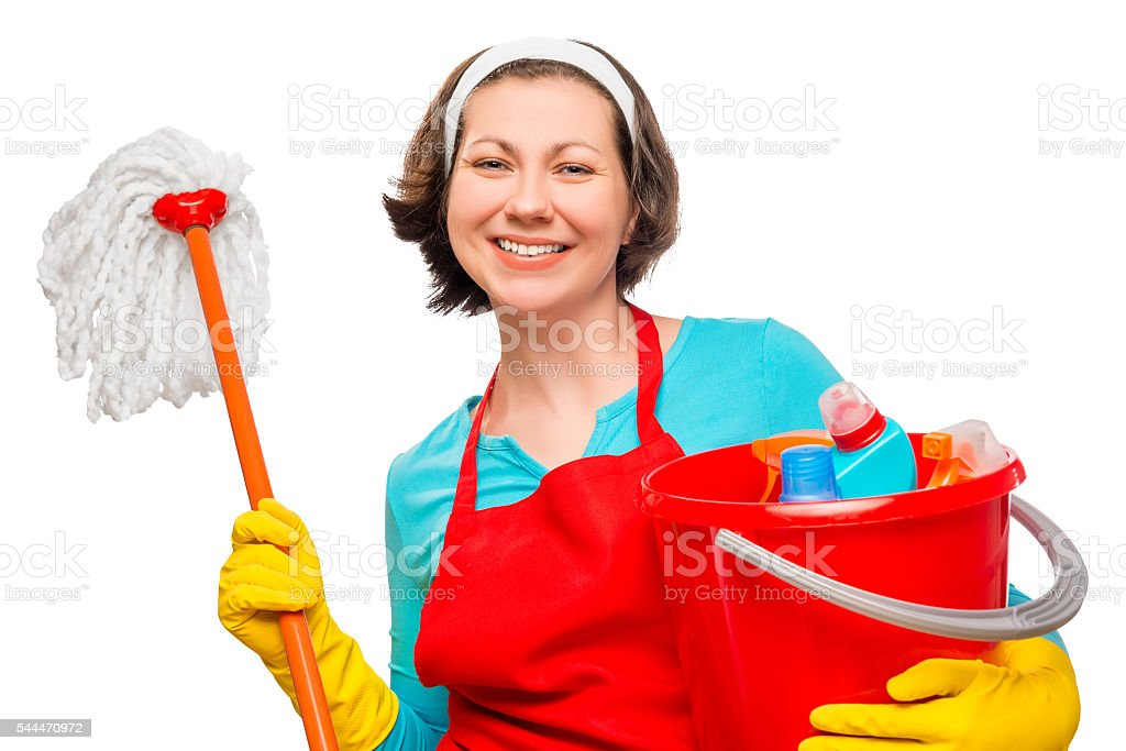 Smiling housewife with a bucket and mop on white background stock photo