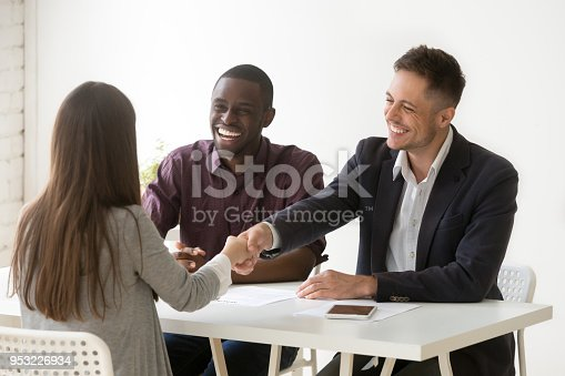 istock Smiling hr handshaking female applicant at job interview, hiring concept 953226934