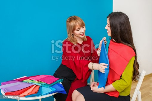 672064598istockphoto smiling image maker works 672064630