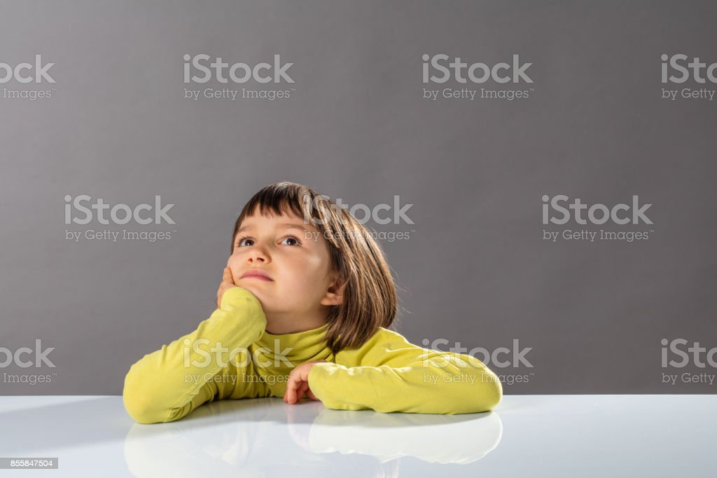 smiling imaginative child looking away for concept of kid curiosity stock photo