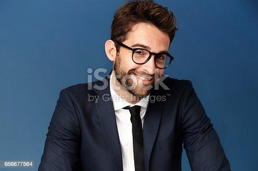 620404536istockphoto Smiling in glasses 656677564