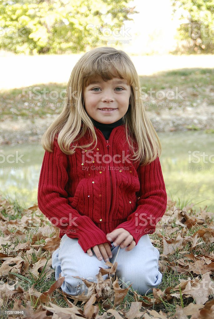 Smiling in the Leaves stock photo