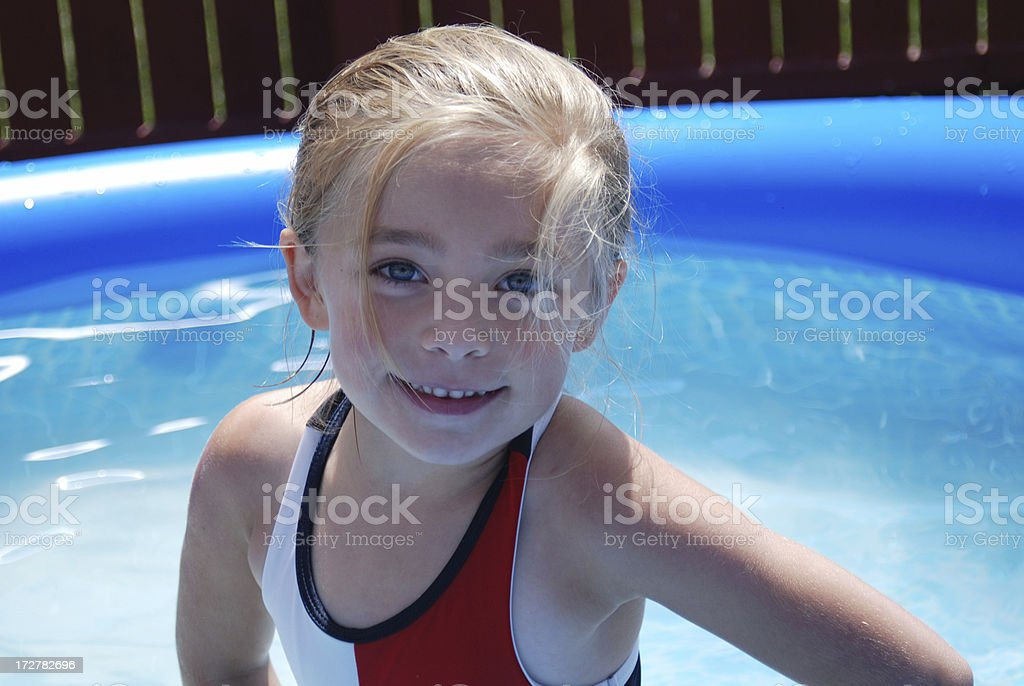 Smiling in the Swimming Pool stock photo