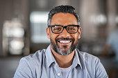 istock Smiling indian man looking at camera 1270067126