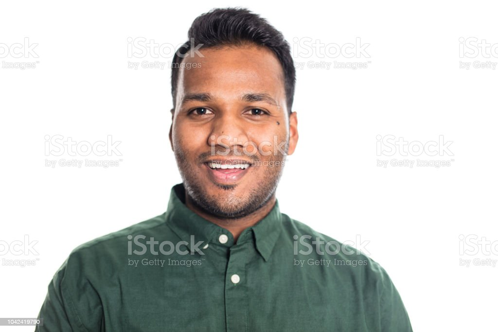Smiling Indian man on white background stock photo