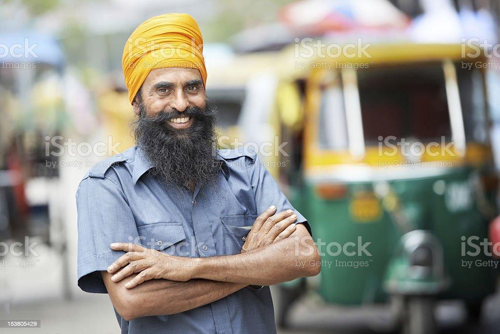 A smiling Indian rickshaw driver stock photo