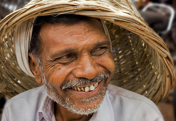 smiling indian senior male - gold tooth stock photos and pictures