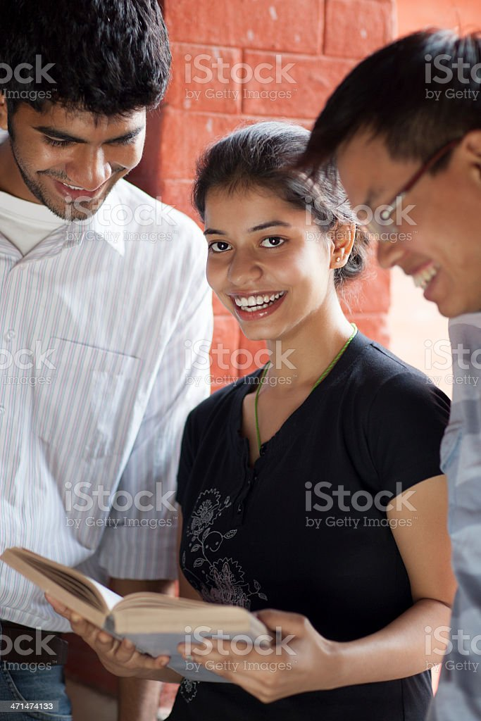 Smiling Indian Students Studying Together stock photo