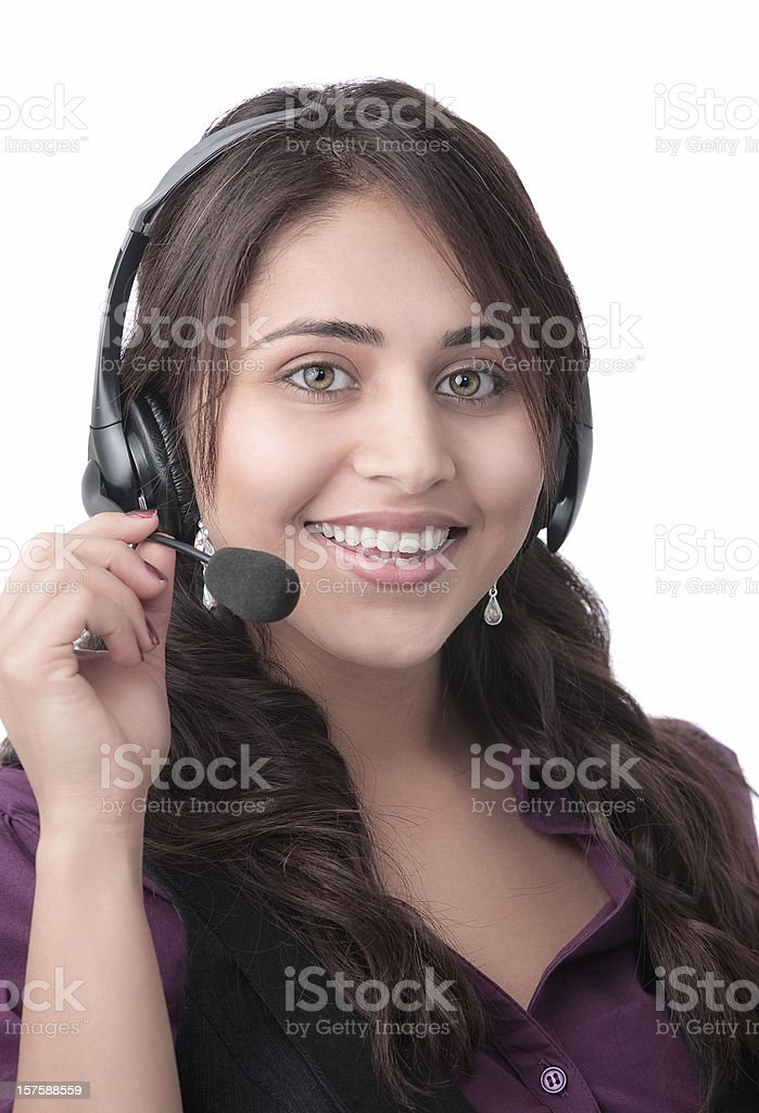 Smiling Indian woman with headset stock photo