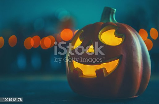 Smiling Jack O'Lantern with party lights
