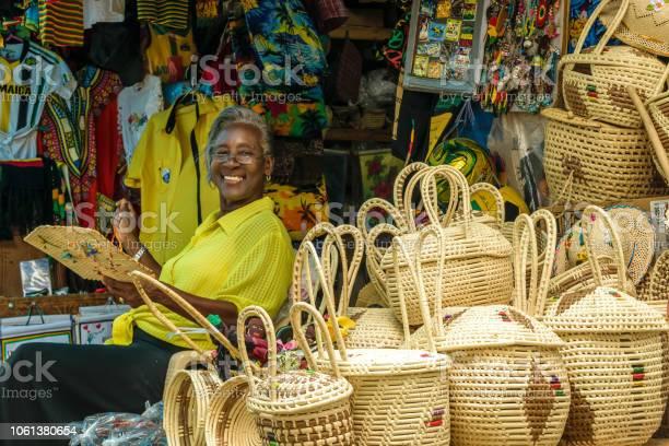 Smiling jamaican female vendor picture id1061380654?b=1&k=6&m=1061380654&s=612x612&h=ojybxl7ridhkvu9kmf49qni1e2udlysqeht8vwyldpi=