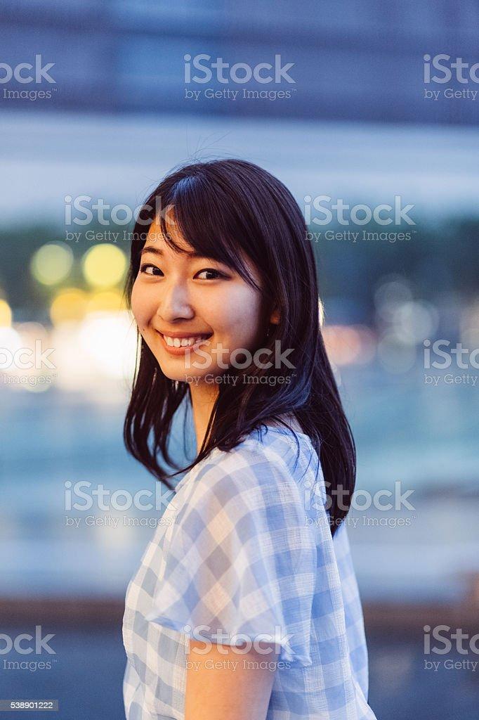 Smiling japanese woman looking at camera stock photo
