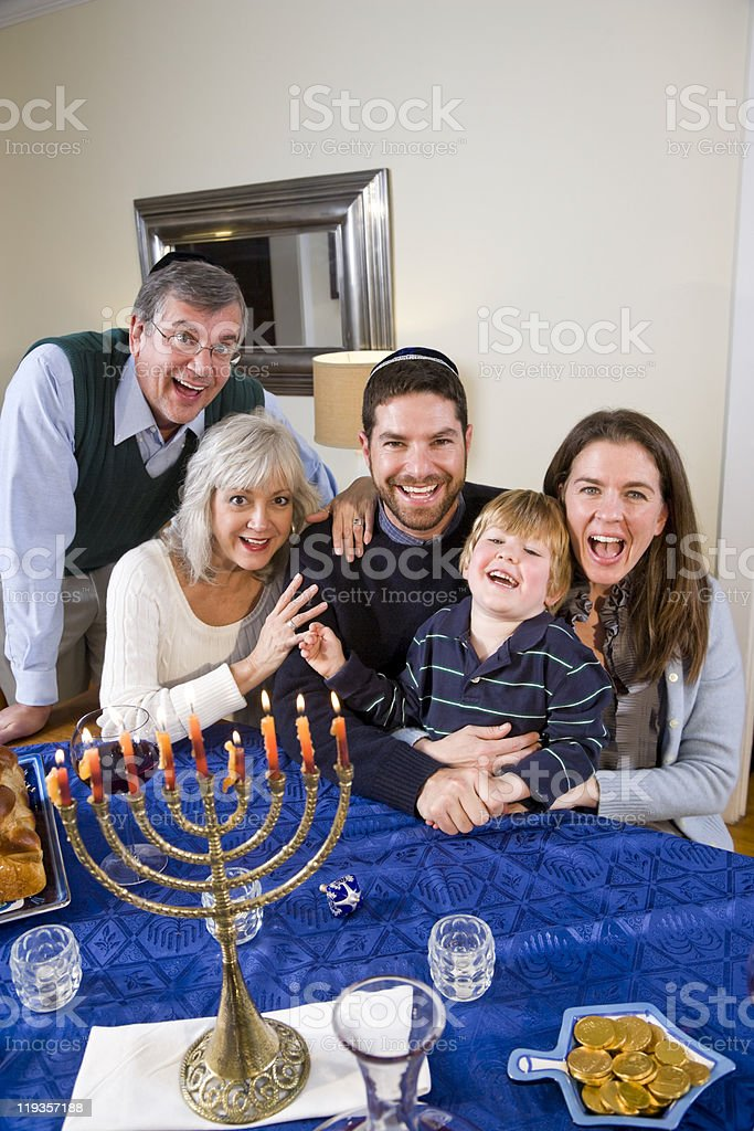 Smiling Jewish family celebrating Chanukah stock photo