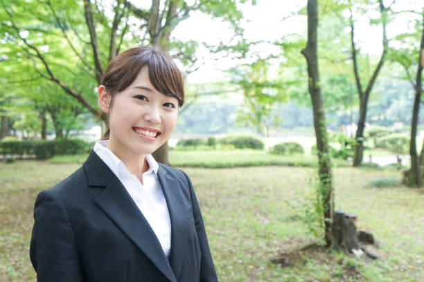 Smiling job-hunting student in suit stock photo