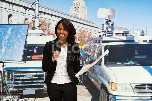 istock Smiling journalist standing outdoors 623964552