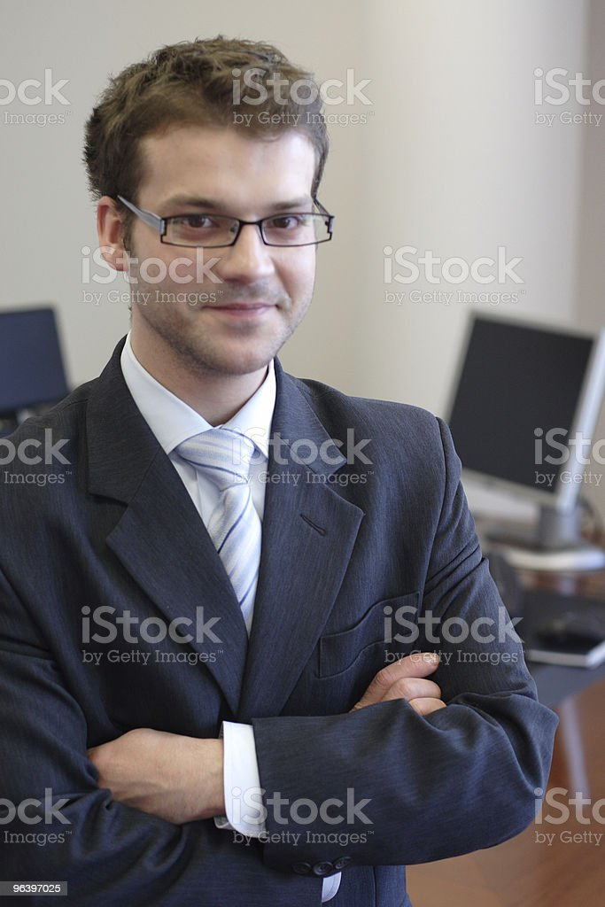 smiling junior executive in his office - portrait royalty-free stock photo