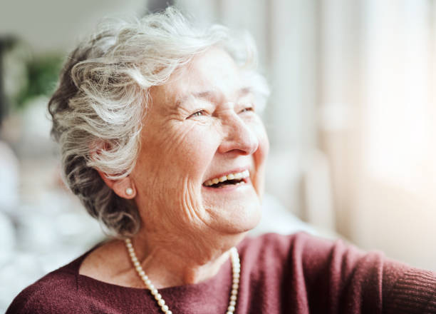 Smiling keeps the soul young Shot of happy senior woman living in a retirement home 80 89 years stock pictures, royalty-free photos & images