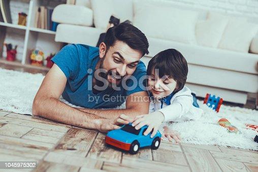 istock Smiling Kid. Father. Leisure Time. Man. Smile. 1045975302
