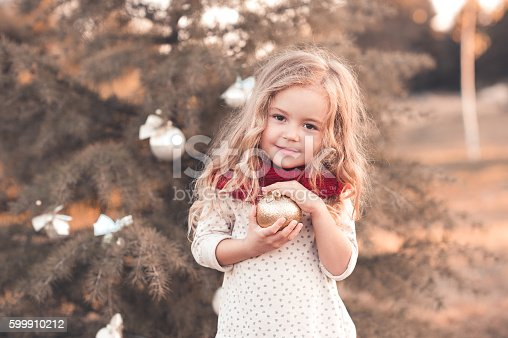 istock Smiling kid girl with christmas decorations 599910212