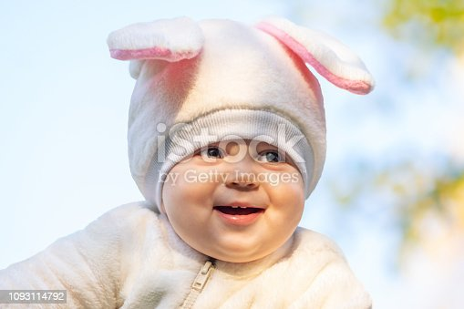 155096501 istock photo Smiling kid with chubby cheeks in rabbit costume 1093114792