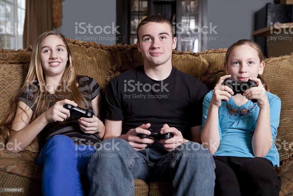 Smiling Kids Playing Video Games royalty-free stock photo