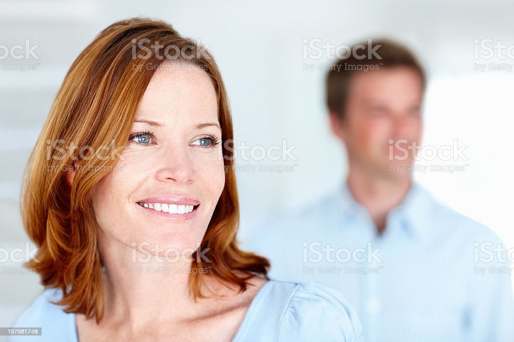 Smiling lady with husband in the background royalty-free stock photo