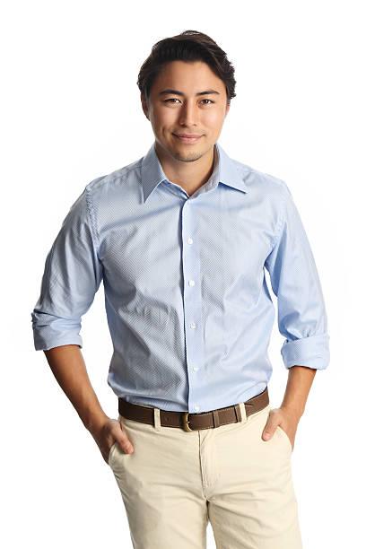 笑顔でのリラックスした男青いシャツ - スマートカジュアル ストックフォトと画像